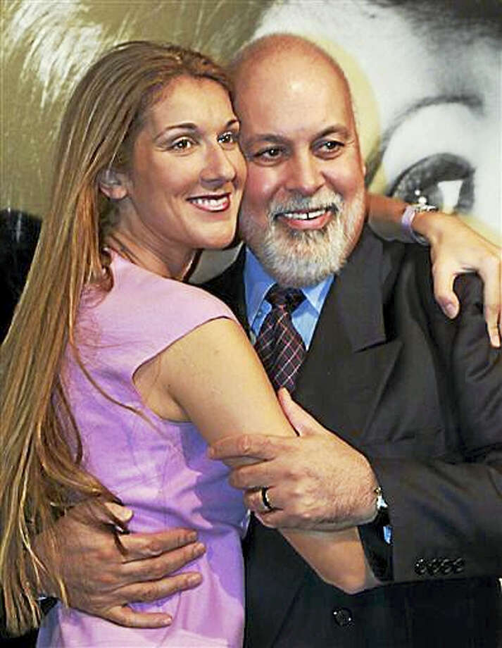 In this Sept. 8, 1999, file photo, singer Celine Dion and her husband Rene Angelil's hug following a news conference in Montreal. This is the first public appearance for Angelil since undergoing cancer treatments. Angelil, Dion's husband and manager, has died at his suburban Las Vegas home, authorities said Thursday, Jan. 14, 2016. He was 73 and had battled throat cancer. Photo: Paul Chiasson/The Canadian Press Via AP, File   / The Canadian Press