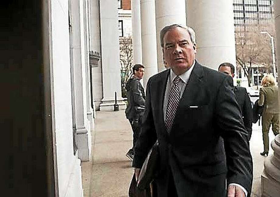 Former Gov. John G. Rowland walks into the federal courthouse in New Haven during his trial for conspiring to violate campaign finance laws. Photo: (File Photo)