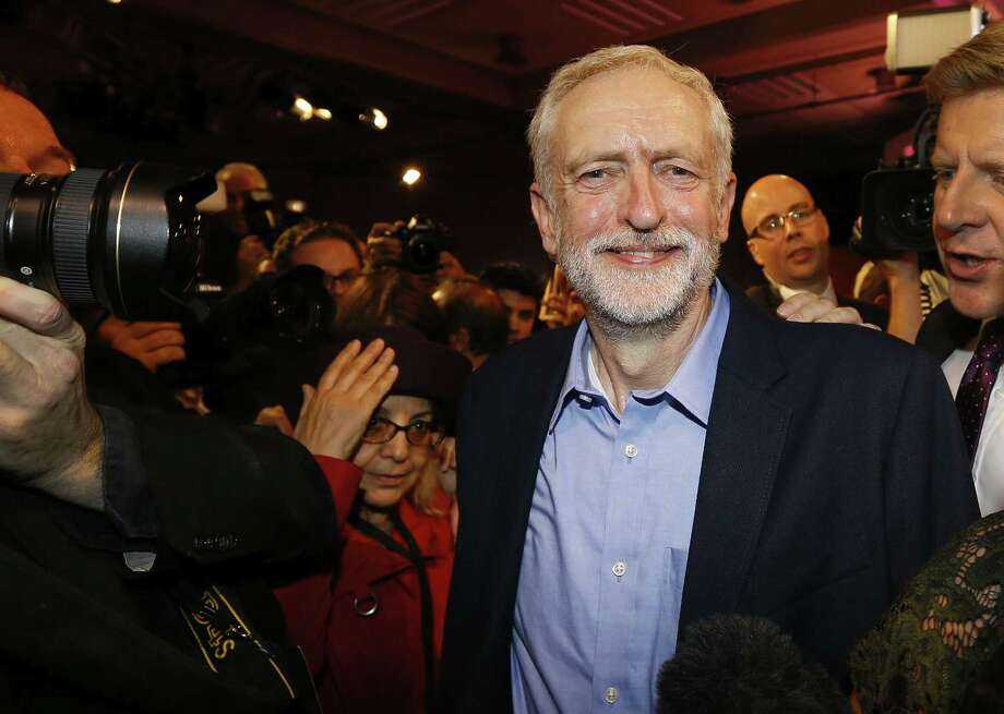Jeremy Corbyn smiles as he leaves the stage  after he is announced as the new leader of The Labour Party during the Labour Party Leadership Conference in London, Saturday, Sept. 12, 2015. Corbyn will now lead Britain's main opposition party. Photo: AP Photo/Kirsty Wigglesworth   / AP