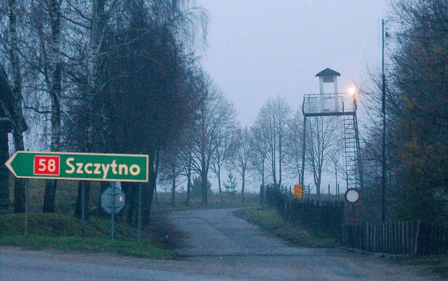 FILE - In this Friday, Dec. 16, 2005 file photo, a watch tower overlooks the area near the Polish intelligence school just outside of Stare Kiejkuty, Poland. Poland is paying a quarter of a million dollars to Abu Zubaydah and Abd al-Rahim al-Nashiri, two terror suspects allegedly tortured by the CIA in its secret facility in this country - prompting outrage among many here who feel they are being punished for American wrongdoing. Photo: (AP Photo/Czarek Sokolowski, File) / AP2005