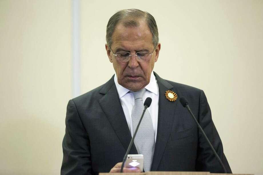 In this file photo, Russian Foreign Secretary Sergey Lavrov checks his phone. Photo:  (Joshua Roberts/ Pool Photo Via AP) / pool reuters