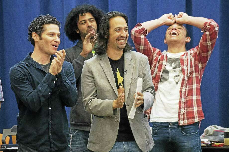 """In this June 18, 2015 photo, """"Hamilton"""" director Thomas Kail, from left, and cast members Daveed Diggs, Lin-Manuel Miranda and Anthony Ramos begin Broadway rehearsals at the New 42nd Street Studios in New York. Photo: Photo By Charles Sykes/Invision/AP, File  / Invision"""