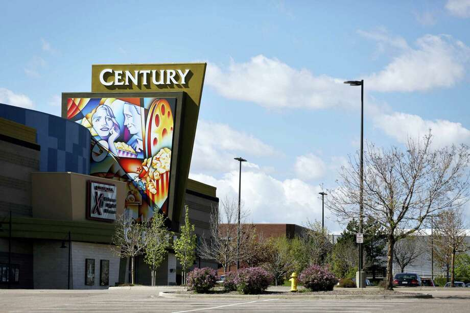 A colorful sign decorates the entrance of the Cinemark Century 16 movie theater in Aurora, Colo. Closing arguments are expected in a civil trial over whether the company that owns a Colorado movie theater should have done more to prevent a shooting that left 12 people dead. Attorneys could make their final appeals to jurors on Wednesday, May 18, 2016. Photo: AP Photo — Brennan Linsley, File / AP
