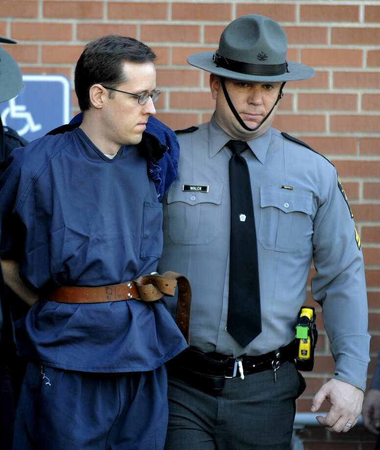 Eric Frein, left, is led from the Pike County Courthouse after his preliminary hearing on Jan. 5, 2015 in Milford, Pa. Frein is charged with fatally shooting a Pennsylvania state trooper and wounded another during an ambush at their barracks in September. Photo: AP Photo/David Kidwell  / ap FRE51292