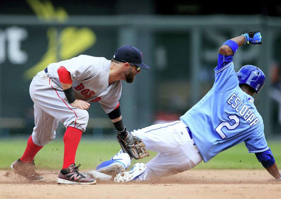 Kansas City's Alcides Escobar beats the tag by Boston second baseman Dustin Pedroia during the eighth inning at Kauffman Stadium in Kansas City, Mo. Escobar stole second base on the play. Photo: ORLIN WAGNER - THE SSOCIATED PRESS  / Copyright 2016 The Associated Press. All rights reserved. This material may not be published, broadcast, rewritten or redistribu