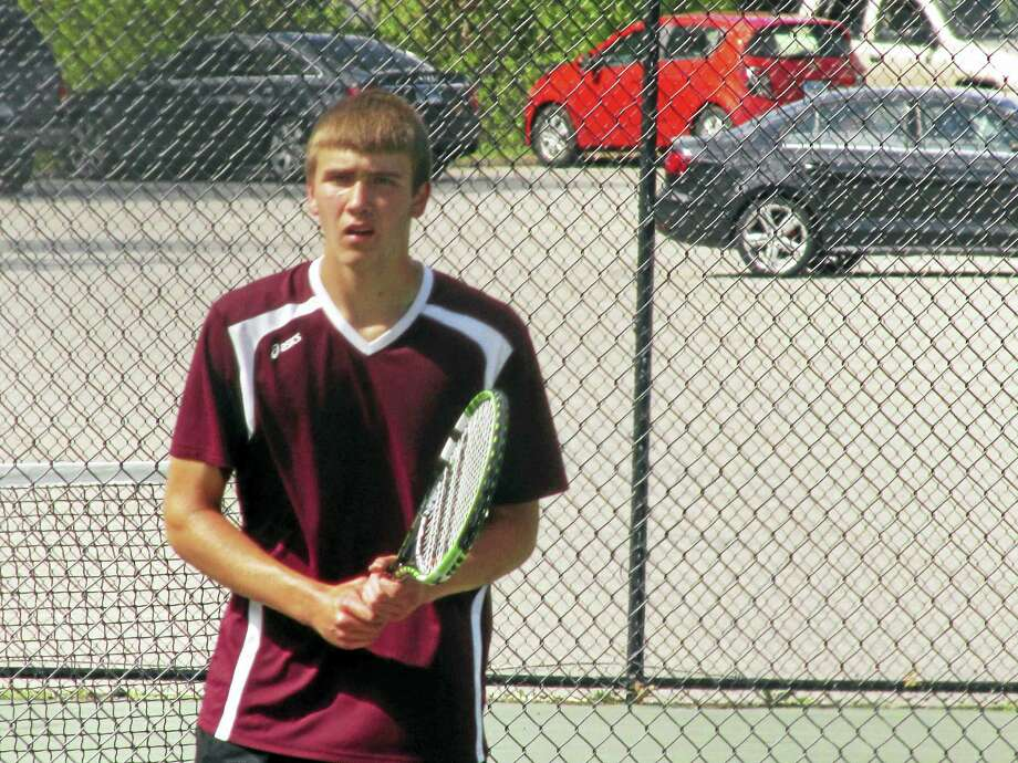 Torrington's Kevin Dixon won two matches in a Red Raider NVL boys tennis tournament semifinal-round loss to Holy Cross Wednesday afternoon at Torrington High School. Photo: Photo By Peter Wallace