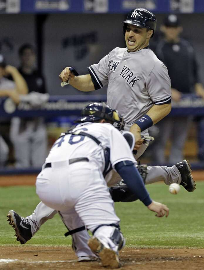 Yankees' Mark Teixeira attempts to beat the tag by Tampa Bay Rays catcher Bobby Wilson (46) while trying to score on a single by Carlos Beltran off Rays pitcher Nathan Karns during the fifth inning Wednesday. Teixeira was out at home on the play and the Rays won 3-2. Photo: Chris O'Meara  — The Associated Press  / AP