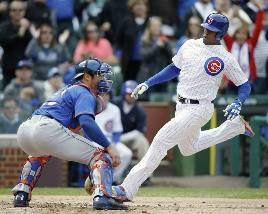 The Cubs' Jorge Soler scores past Mets catcher Anthony Recker in the fifth inning on Thursday. Photo: Andrew A. Nelles — The Associated Press  / FR170974 AP