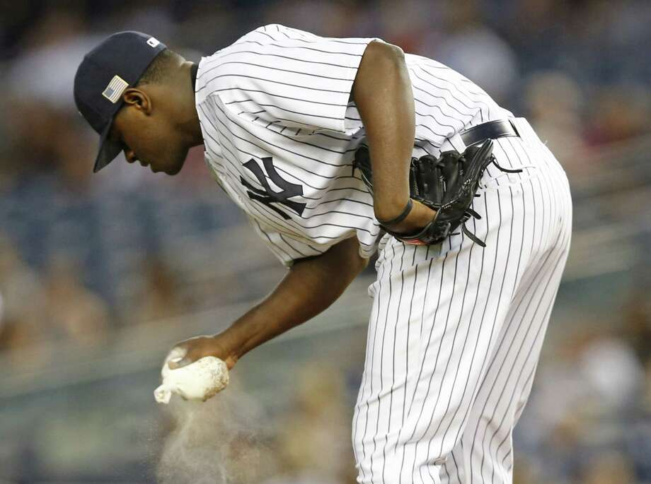 Yankees starting pitcher Luis Severino drops the rosin bag after allowing a two-run home run to Justin Smoak on Friday. Photo: Kathy Willens — The Associated Press  / AP