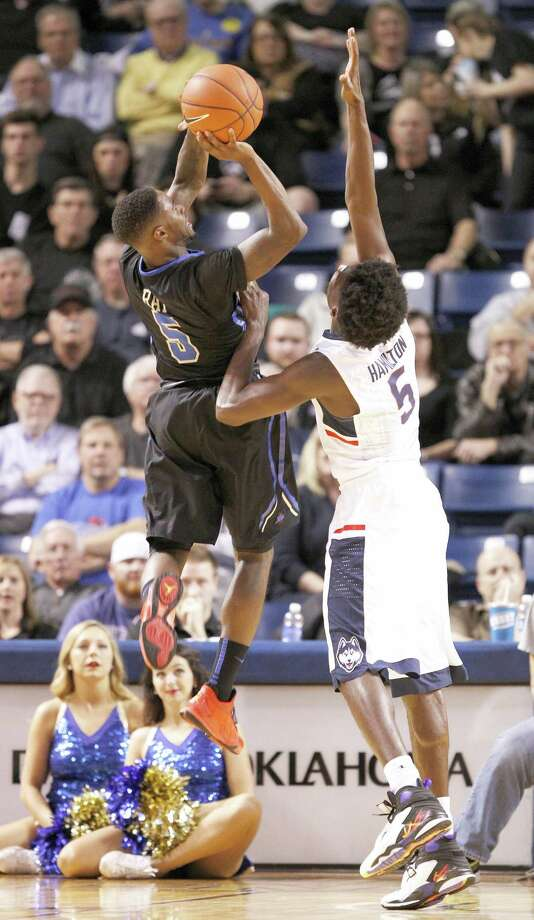 Tulsa's Rashad Ray, upper left, shoots over UConn's Daniel Hamiton during the second half on Thursday. Photo: Dave Crenshaw — The Associated Press  / FR41373 AP