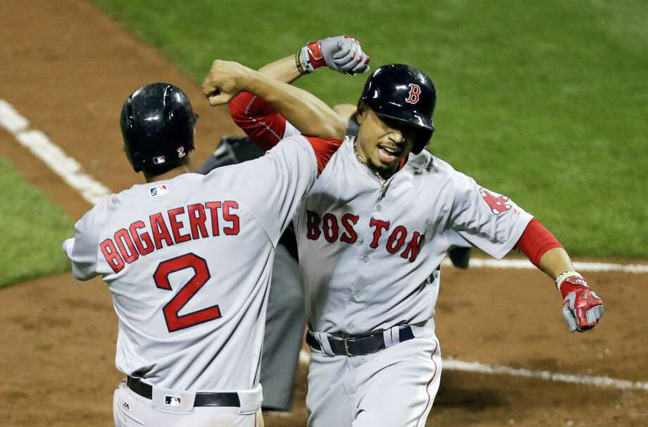 Mookie Betts, right, celebrates with Xander Bogaerts after Betts homered in the third inning on Monday. Photo: Patrick Semansky — The Associated Press  / Copyright 2016 The Associated Press. All rights reserved.