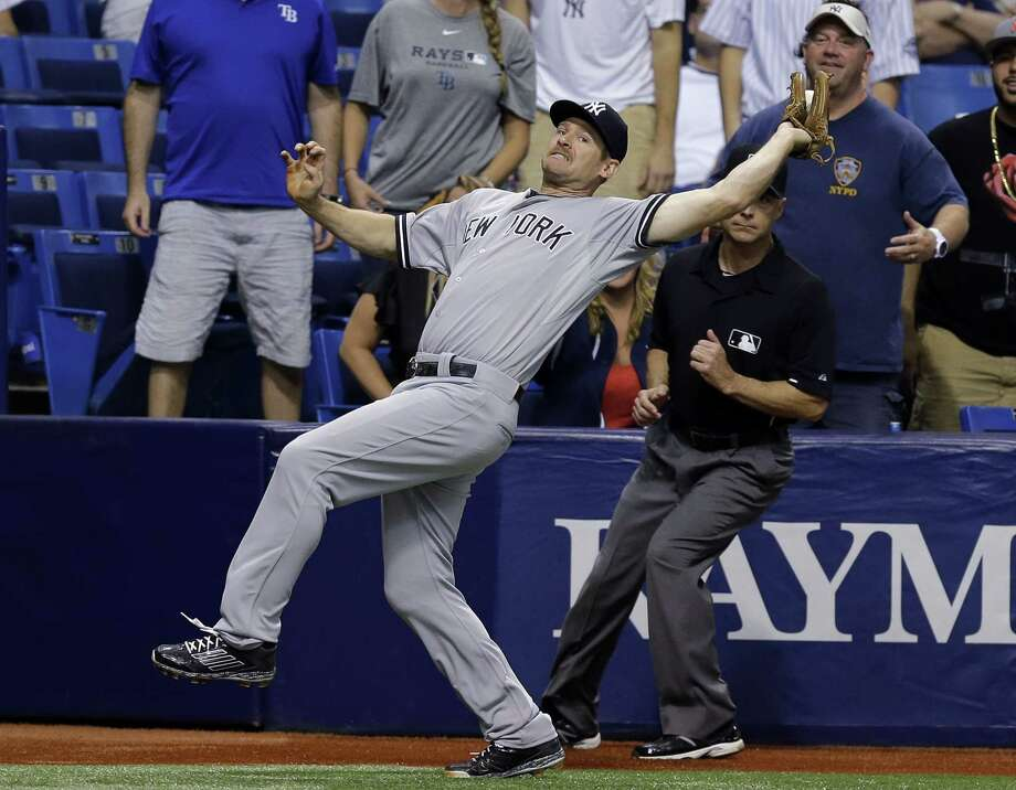 Yankees third baseman Chase Headley makes an off-balance catch on a foul pop by Rene Rivera during the eighth inning on Thursday. Photo: Chris O'Meara — The Associated Press  / AP