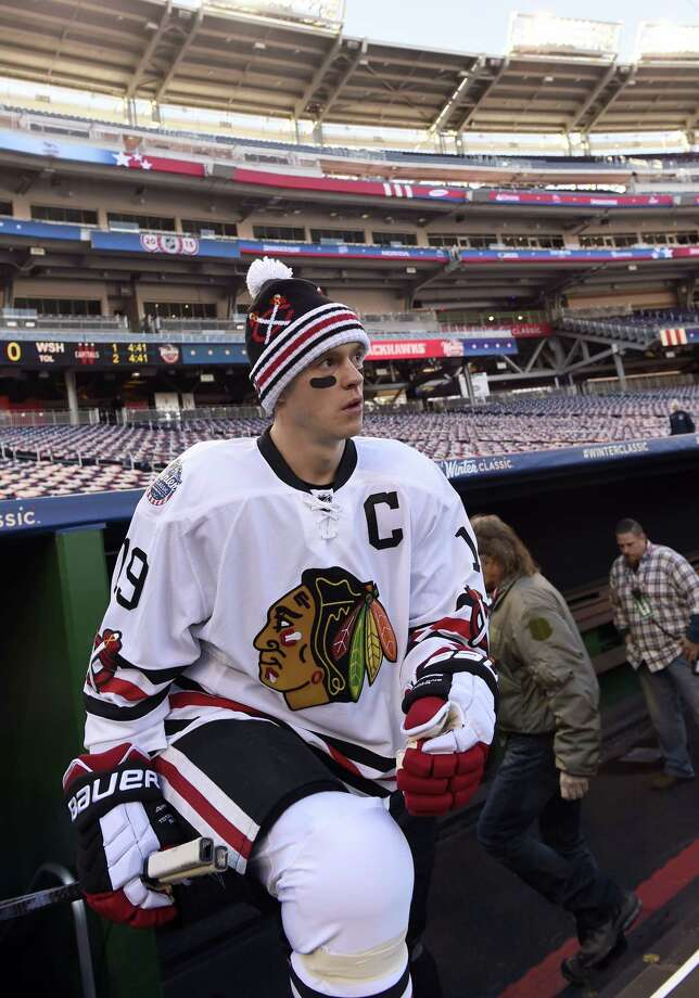 Chicago Blackhawks center Jonathan Toews walks out of the visiting team dugout at Nationals Park on Dec. 31 for practice in preparation for the Winter Classic. Photo: Susan Walsh — The Associated Press File Photo  / AP