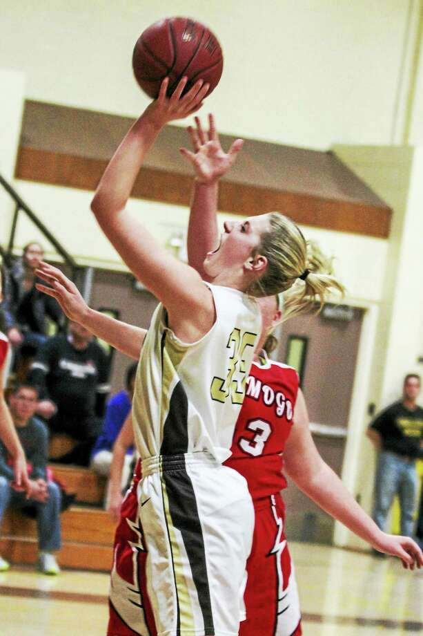 Thomaston center Casey Carangelo had 22 points in a win over Wamogo Thursday night. Photo: Marianne Killackey — Special To Register Citizen  / 2015