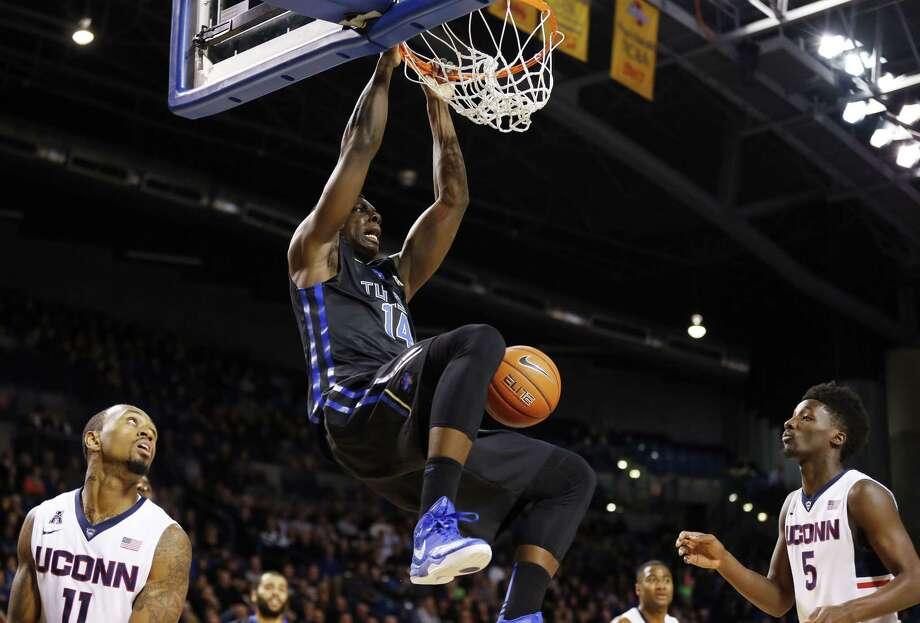 Tulsa's T.K. Edogi dunks against UConn Tuesday night at the Reynolds Center in Tulsa, Okla. Photo: Cory Young — Tulsa World  / Tulsa World