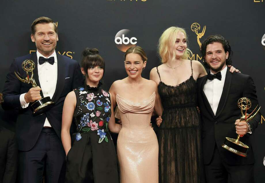 """Nikolaj Coster-Waldau, from left, Maisie Williams, Emilia Clarke, Sophie Turner, and Kit Harington winners of the award for outstanding drama series for """"Game of Thrones"""" pose in the press room at the 68th Primetime Emmy Awards on Sunday, Sept. 18, 2016, at the Microsoft Theater in Los Angeles. Photo: (Photo By Jordan Strauss/Invision/AP) / Invision"""