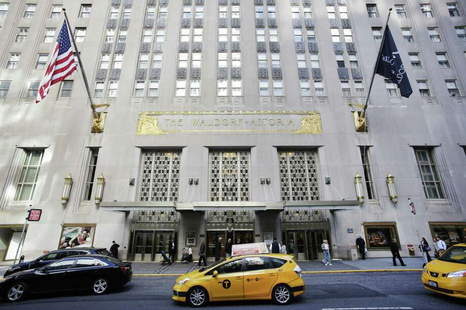 In this Oct. 6, 2014 file photo, a taxi passes in front of the fabled Waldorf Astoria hotel in New York. It's official. The U.S. government says itís abandoning decades of tradition and moving out of New York's famed Waldorf-Astoria Hotel, which a Chinese firm bought last year from Hilton Worldwide. Photo: AP Photo/Mark Lennihan, File   / AP