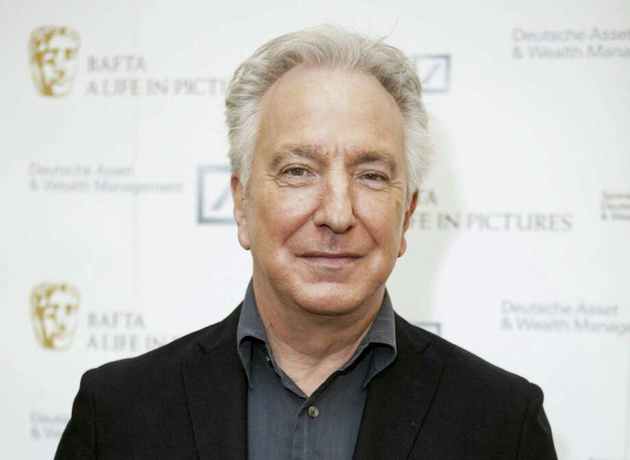 "In this Wednesday, April 15, 2015 photo, British actor Alan Rickman poses for photographers on arrival at 'BAFTA A Life In Pictures, with Alan Rickman' in central London. Rickman, whose career ranged from Britain's Royal Shakespeare Company to the ""Harry Potter"" films, has died at 69.  Rickman's family said Thursday, Jan. 14, 2016 that the actor had died after a battle with cancer. Photo: Photo By Grant Pollard/Invision/AP, File   / Invision"