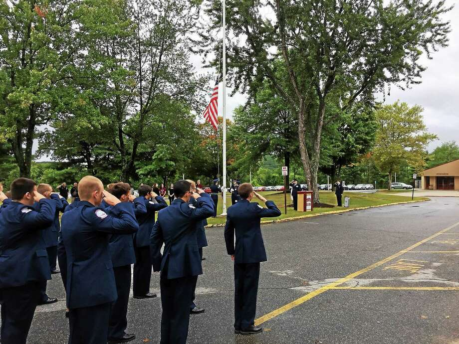 A remembrance ceremony marking the 14th anniversary of the Sept. 11 terrorist attacks was held Friday morning at Torrington High School. Photo: Ben Lambert — The Register Citizen