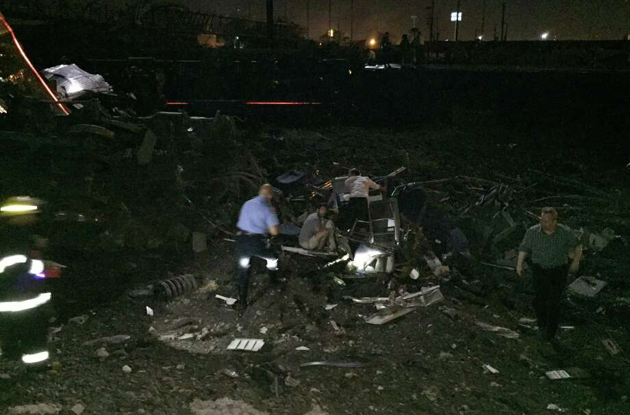 Authorities investigate the scene of an Amtrak train crash Tuesday in Philadelphia. An Amtrak train headed to New York City derailed and crashed in Philadelphia. Photo: AP Photo  / AP