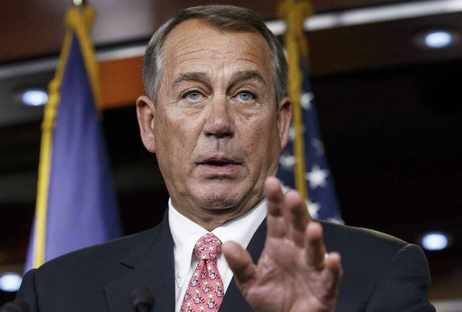 FILE - In this Dec. 11, 2014, file photo, House Speaker John Boehner of Ohio speaks during a news conference on Capitol Hill in Washington. Michael R. Hoyt, a resident of Cincinnati and bartender with a history of psychiatric illness, was indicted last week on a charge of threatening to murder Boehner, possibly by poisoning his drink, according to records made available Tuesday, Jan. 13, 2015. (AP Photo/J. Scott Applewhite, File) Photo: AP / AP