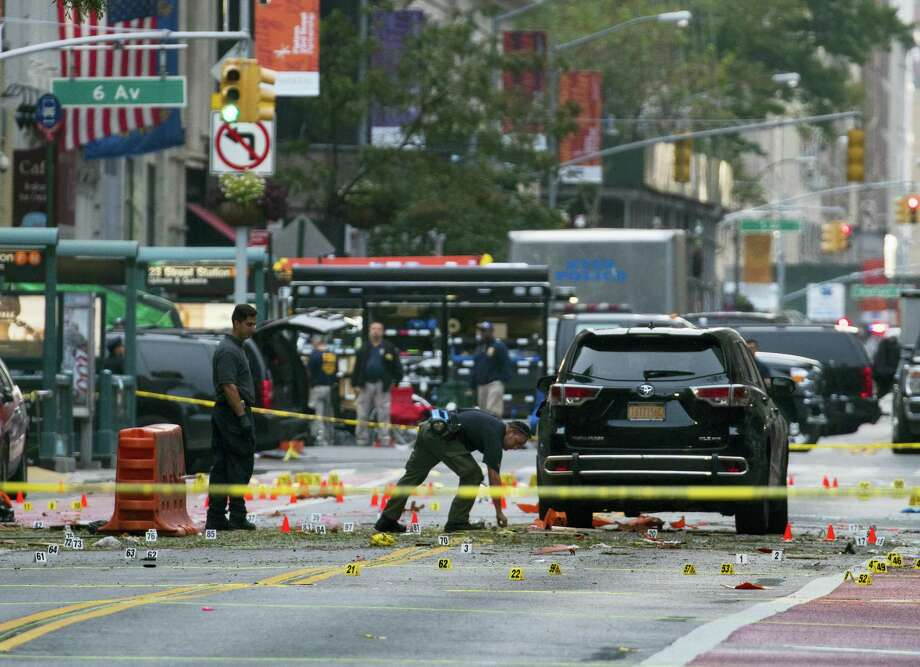 Crime scene investigators work at the scene of Saturday's explosion in Manhattan's Chelsea neighborhood, in New York on Sept. 18, 2016. Photo: AP Photo/Craig Ruttle  / FR61802 AP