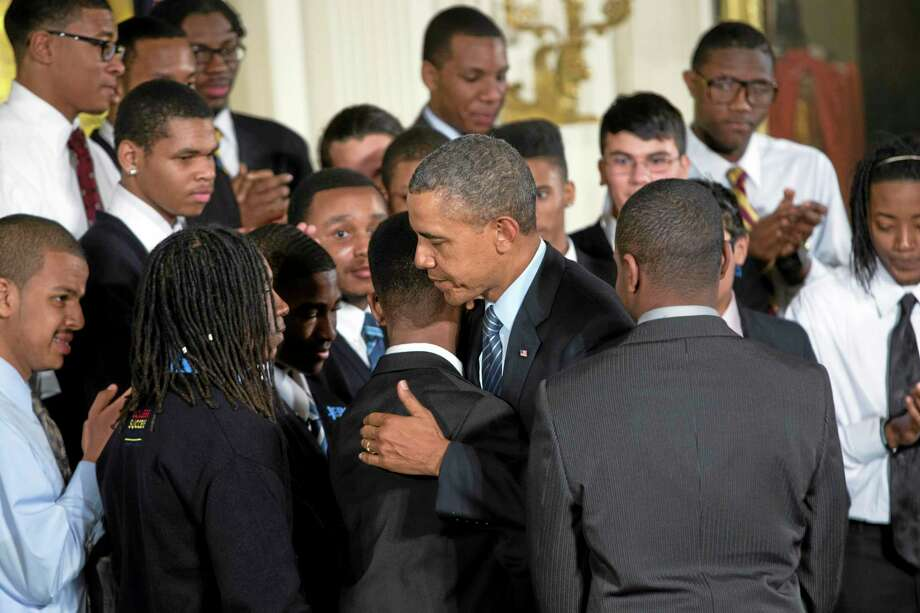 """President Barack Obama hugs a student during an event in the East Room of the White House to promote his """"My Brother's Keeper"""" initiative, on Feb. 27, 2014 in Washington. Joined at the White House by young men of color, Obama called on America's businesses, philanthropists and government leaders to join forces to put more boys on a path toward successful lives. Photo: AP Photo/ Evan Vucci  / AP"""