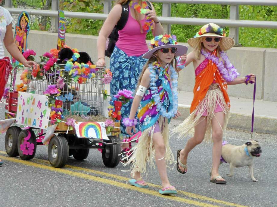 "The ""Bahama Mamas"" Ava Wagnanen and Olivia Travaglin won the 2013 parade's overall top prize. Photo: Register Citizen File Photo"