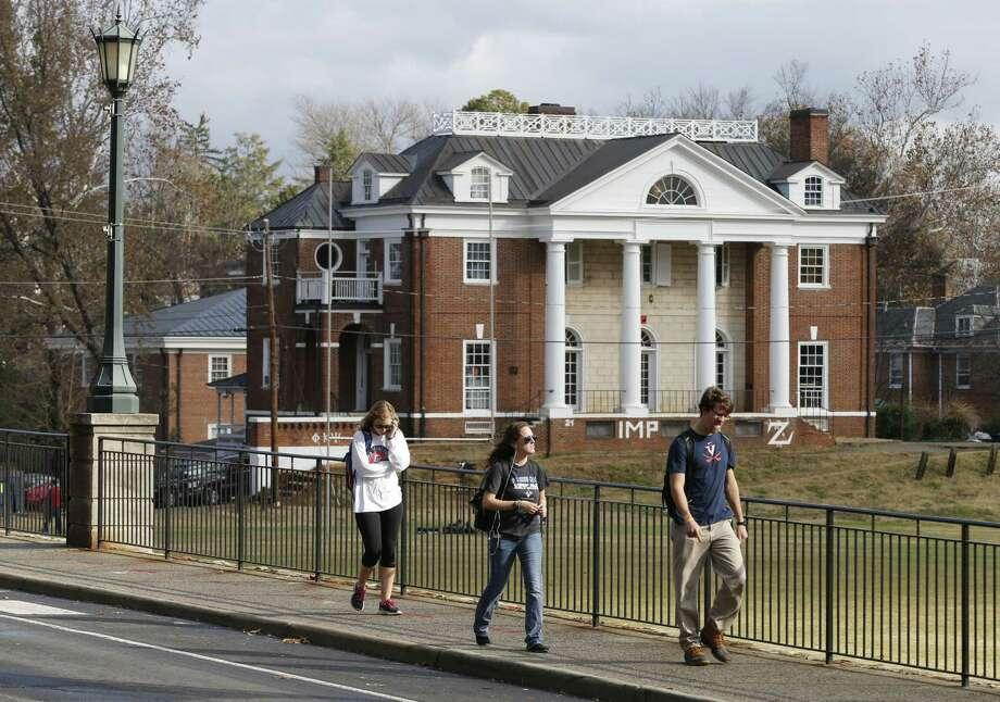 In this Nov. 24, 2014, file photo, University of Virginia students walk to campus past the Phi Kappa Psi fraternity house at the University of Virginia in Charlottesville, Va. Photo: AP File Photo  / AP