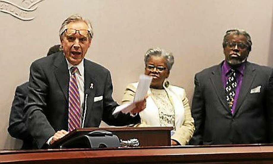 Rep. Peter Tercyak, with Sen. Marilyn Moore and Bishop John Selders in the background, Photo: CHRISTINE STUART PHOTO
