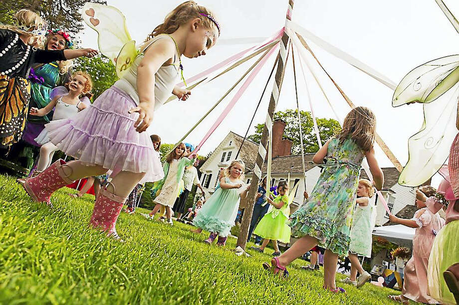 Photos by Tom Bombria, courtesy of Connecticut Landmarks Children dance around the Maypole at the Bellamy-Ferriday House & Garden in Bethlehem; the fairy festival will be held again on Sunday, May 21. Photo: Journal Register Co. / 2015 Tom Bombria