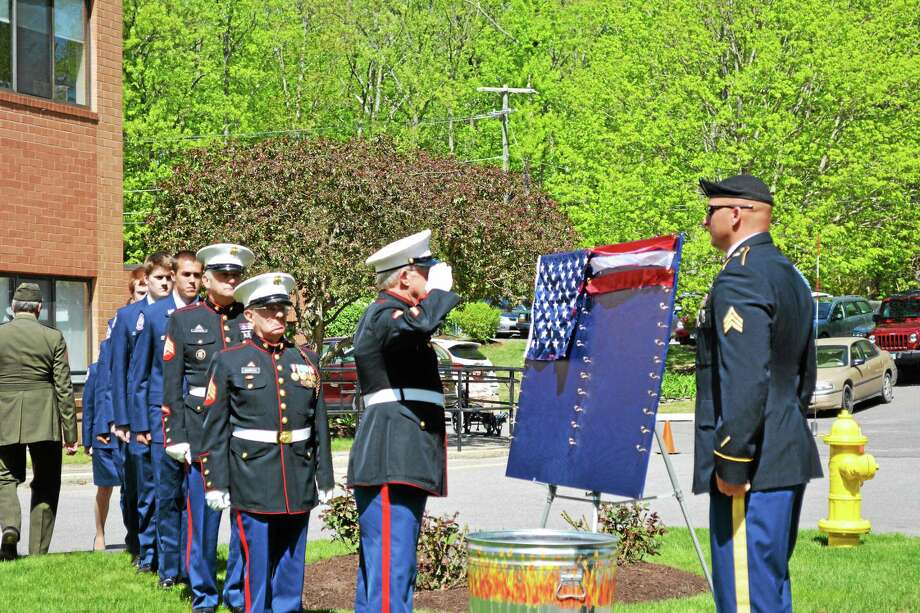 A dedication ceremony was held to unveil the new Wall of Honor at Litchfield Woods Health Care Center on Thursday, honoring the veteran residents of the facility. Photo: Amanda Webster — The Register Citizen