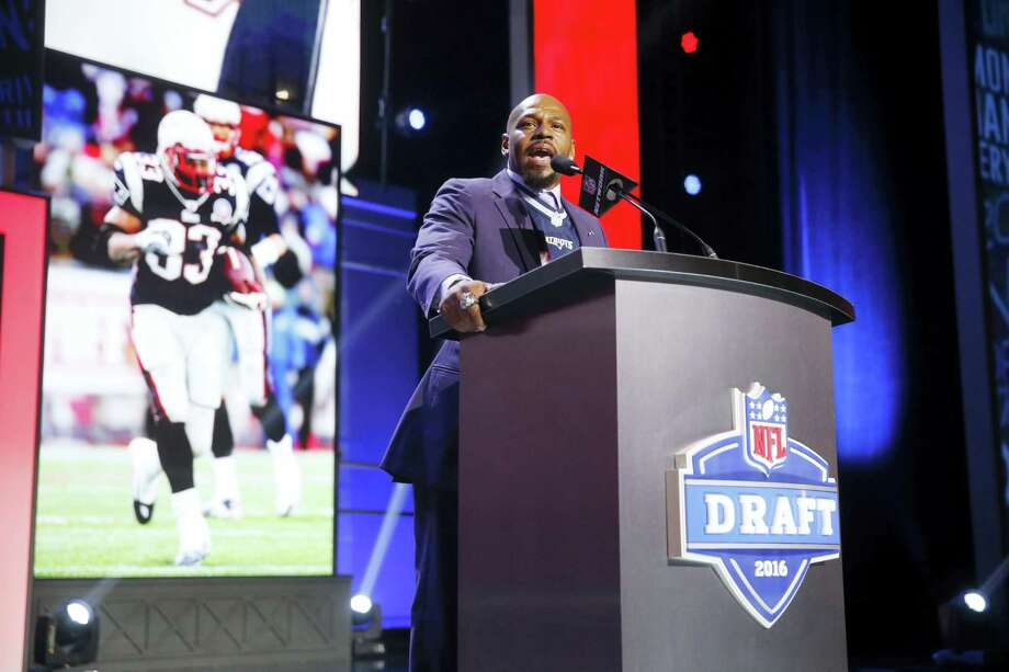 Former Walter Payton Men of the Year Kevin Faulk, announcing the Patriots draft pick last month, has been voted into the Patriots Hall of Fame. Photo: The Associated Press  / AP