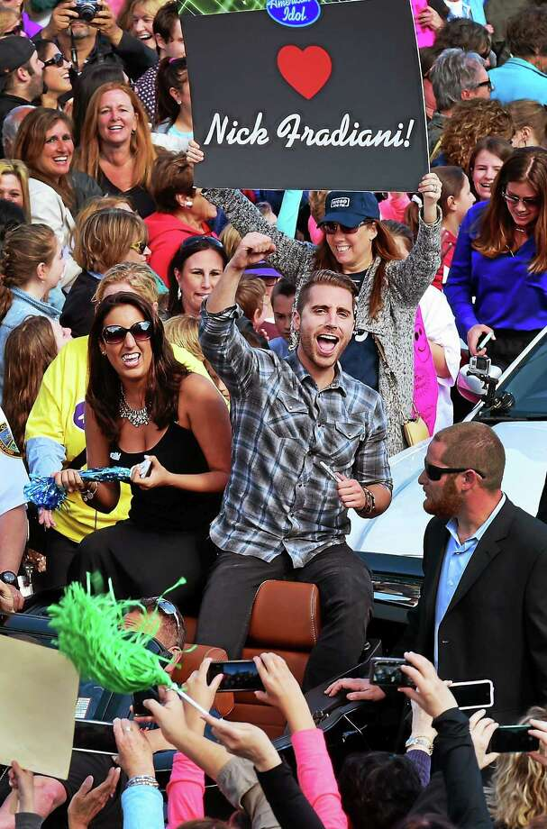 """American Idol's"" Nick Fradiani gives a fist pump to a familiar face during a welcome home parade on Whitfield Street in Guilford on May 1. Fradiani won season 14's competition on Wednesday. Photo: Peter Hvizdak — New Haven Register  / ?2015 Peter Hvizdak"