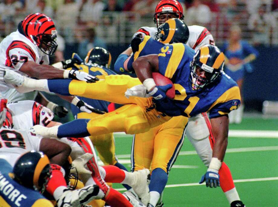 L.G. Patterson — The Associated Press This Sunday, Sept. 1, 1996,  file photo shows St. Louis Rams running back Lawrence Phillips (21) leaping over a mound of players as he scores against the Cincinnati Bengals in St. Louis, Mo. Former NFL running back, Phillips was found dead in his California prison cell early Wednesday, Jan. 13, 2016, and officials said they suspect suicide. Photo: AP / AP
