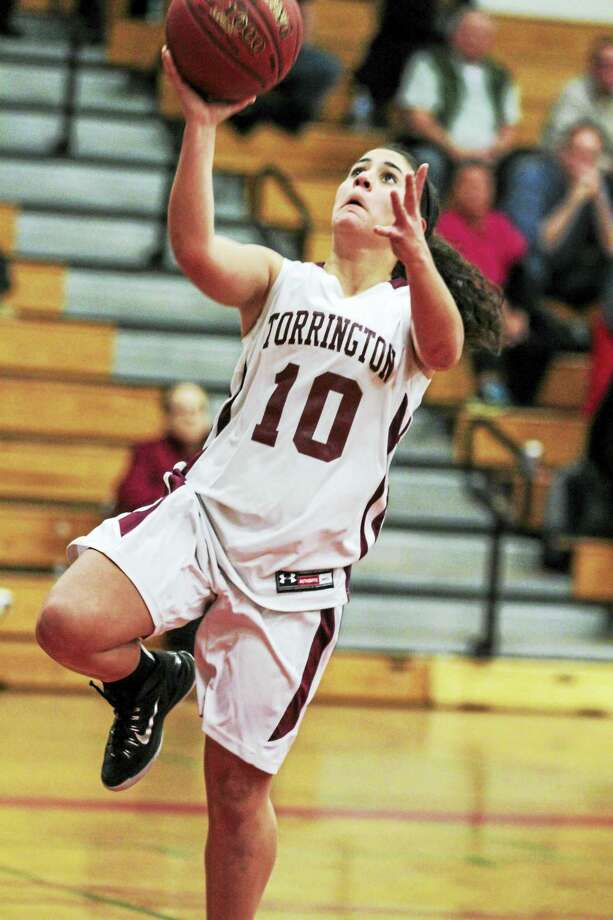 Torrington's Alexis Tyrrell drives in for a basket against Ansonia Wednesday night. Tyrell led the Raiders past Ansonia with 16 points. Photo: Marianne Killackey — Special To Register Citizen  / 2015
