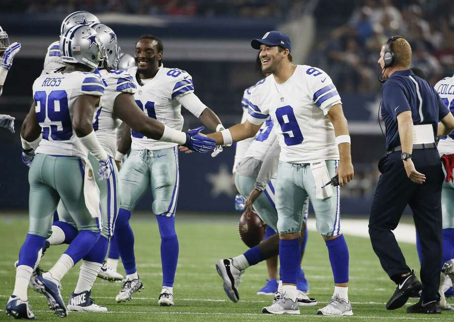 Dallas Cowboys quarterback Tony Romo (9) celebrates a touchdown by defensive back Corey White (23) during a Sept. 3 preseason game against the Houston Texans in Arlington, Texas. Photo: Tony Gutierrez — The Associated Press  / AP
