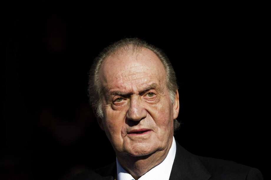 FILE - In this Tuesday, Dec. 27, 2011, file photo, Spain's King Juan Carlos leaves after the official opening of the Parliament, in Madrid. Spainís Supreme Court said Wednesday Jan. 14, 2015, it will investigate a paternity claim filed against former King Juan Carlos by a Belgian woman alleges she is his daughter and was born after her mother had a relationship with him in the 1960s while he was crown prince.  Carlos while king was immune from criminal prosecution and civil lawsuits, but lost immunity after he abdicated in June 2014. (AP Photo/Daniel Ochoa de Olza, File) Photo: AP / AP
