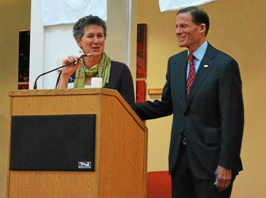 Barbara Spiegel, executive director of the Susan B. Anthony Project, has announced she will retire in June. She is seen here with U.S. Sen. Richard Blumenthal during a vigil. Photo: Register Citizen File Photo