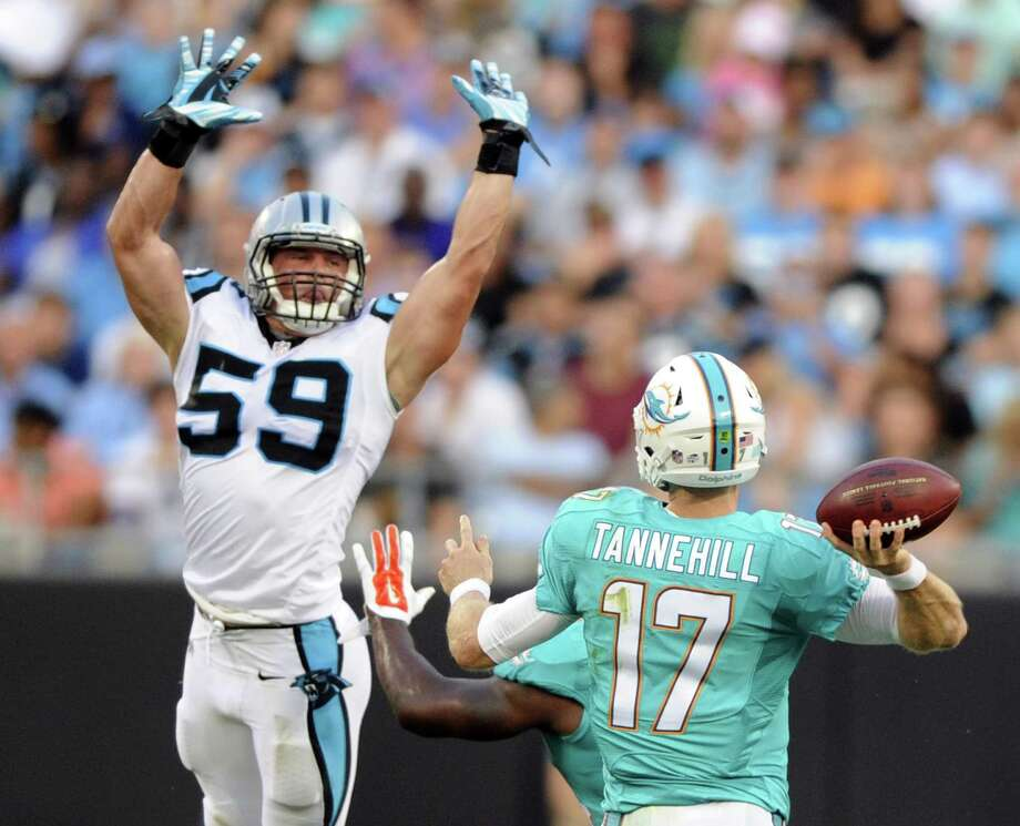 Luke Kuechly has agreed to a five-year, $62 million contract extention with the Carolina Panthers, making him the highest-paid middle linebacker in the NFL. Photo: Mike McCarn — The Associated Press File Photo  / FR34342 AP