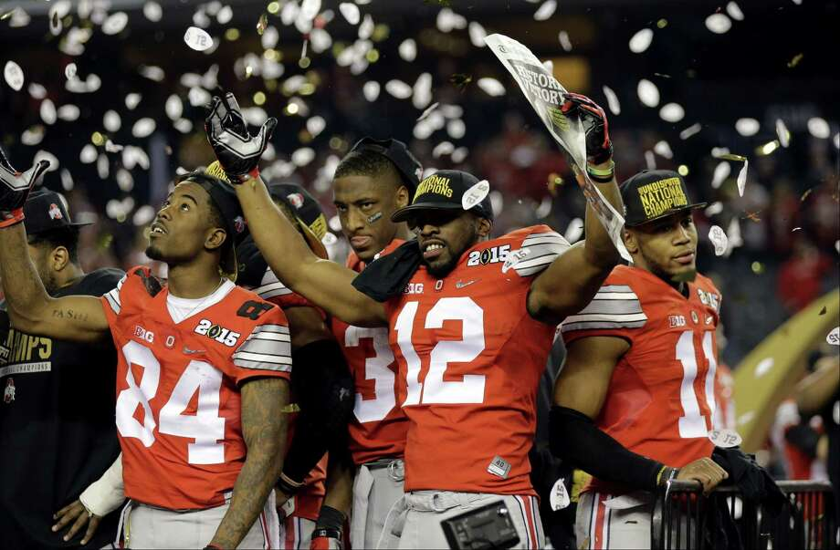 Ohio State players celebrate after beating Oregon in the championship game Monday in Arlington, Texas. Ohio State won 42-20. Photo: Eric Gay — The Associated Press  / AP