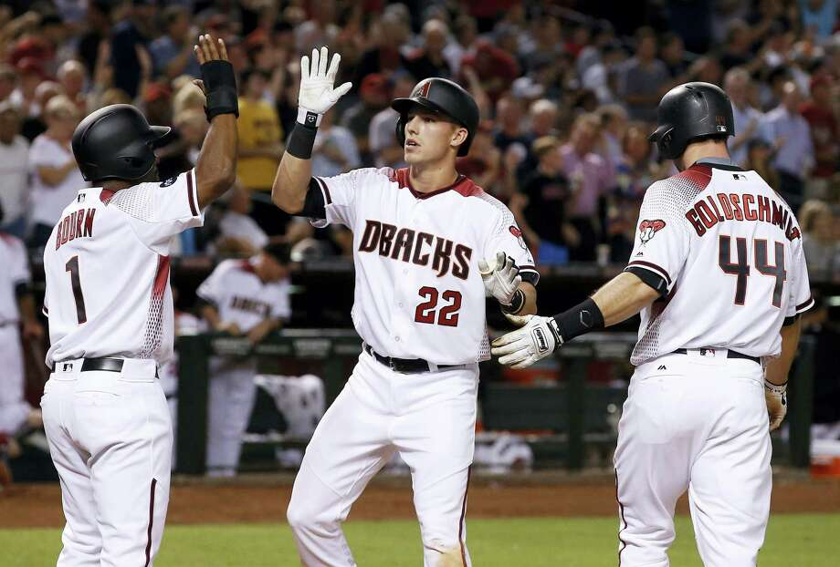 Arizona Diamondbacks' Jake Lamb (22) arrives at home plate to celebrate his three-run home run against the New York Yankees with Michael Bourn (1) and Paul Goldschmidt (44) during the fifth inning Monday in Phoenix. Photo: Ross D. Franklin — The Associated Press  / Copyright 2016 The Associated Press. All rights reserved. This material may not be published, broadcast, rewritten or redistribu
