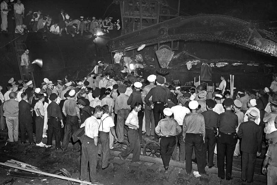 FILE - In this Sept. 7, 1943 file photo, rescue crews dig through debris of wrecked Pennsylvania Railroad's Congressional Limited, with the aid of arc lamps, in search of additional victims of the accident in Philadelphia. The Labor Day train jammed with 541 passengers derailed, killing 79 passengers and injuring 117 others. The May 12, 2015 derailment of an Amtrak train in Philadelphia was not the first rail disaster to occur in that area. The high-speed Congressional Limited jumped the rails in an area known as Frankford Junction. It is about a mile from where the Amtrak wreck occurred Tuesday night. Photo: (AP Photo/Murray Becker, File) / AP