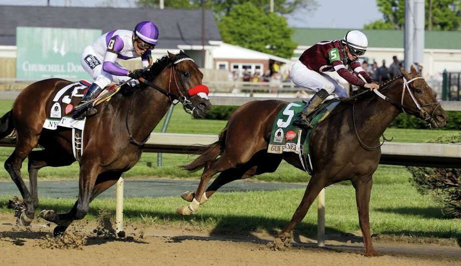 Nyquist, left, rides past Gun Runner during the Kentucky Derby. Photo: The Associated Press File Photo  / AP