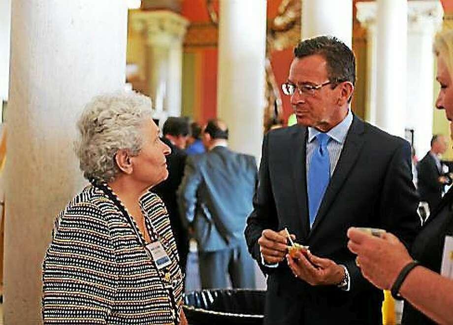 Carla Squatrito, president and founder of Carla's Pasta, talks to Gov. Dannel Malloy. Photo: Courtesy Christine Stuart — CT News Junkie