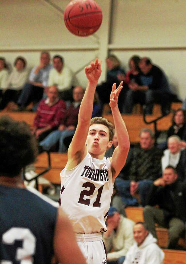 Torringtonís Tim Considine goes up for a jump shot in the Red Raiders' 57-36 loss to Ansonia. Photo: Marianne Killackey — Special To The Register Citizen  / 2014