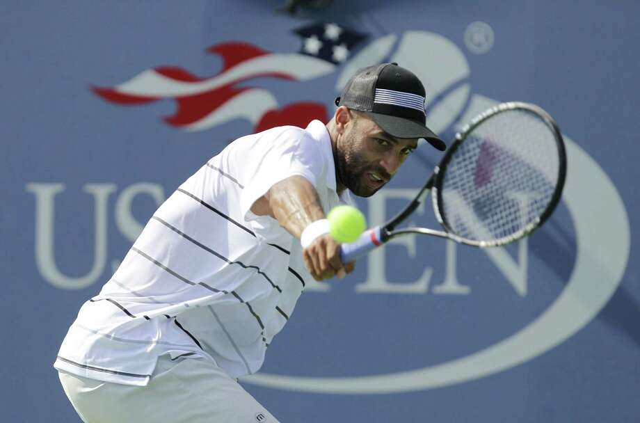 In this Aug. 27, 2012 photo, James Blake returns a shot to Lukas Lacko, of Slovakia, in the first round of play at the 2012 U.S. Open Tennis tournament in New York. Photo: AP Photo/Kathy Willens, File  / AP