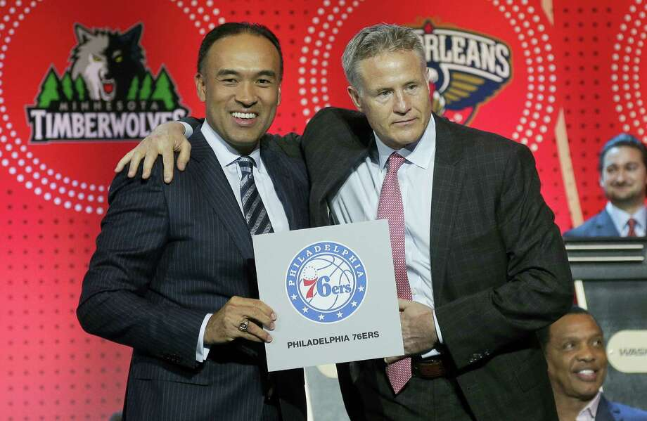 NBA deputy commissioner Mark Tatum, left, poses for a photo with Philadelphia 76ers head coach Brett Brown during the NBA draft lottery on Tuesday. Photo: Julie Jacobson — The Associated Press  / Copyright 2016 The Associated Press. All rights reserved. This material may not be published, broadcast, rewritten or redistribu
