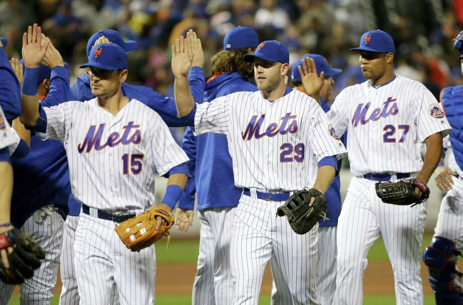 The Mets' Matt Reynolds (15), Eric Campbell (29) and Jeurys Familia (27) celebrate with teammates after Tuesday's win over the Nationals. Photo: Frank Franklin II — The Associated Press  / Copyright 2016 The Associated Press. All rights reserved. This material may not be published, broadcast, rewritten or redistribu