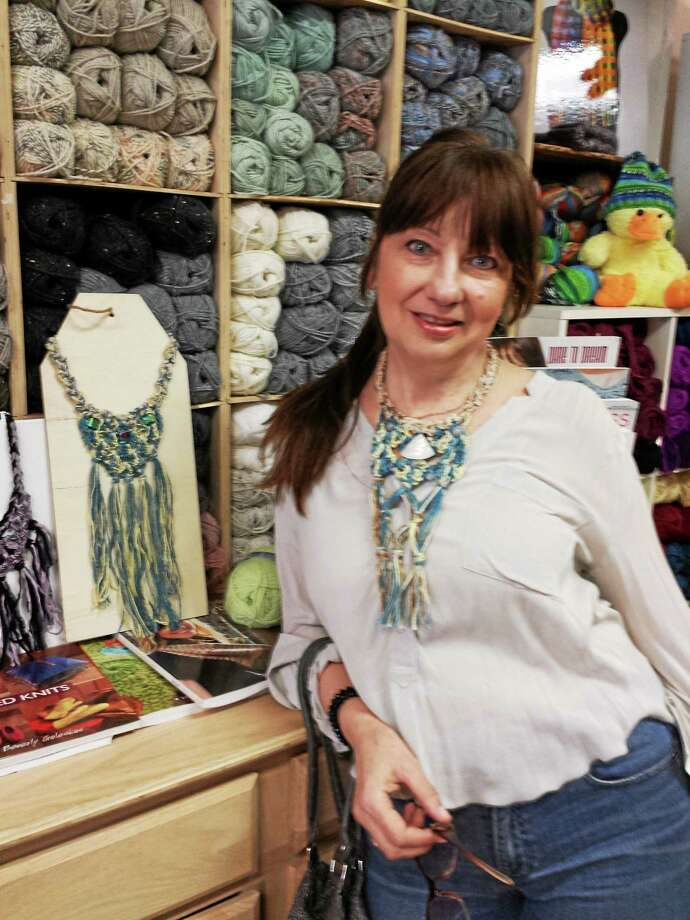 Photo by Ginger Balch  Torrington resident Olga Zvezdina loves to take crochet and create beautiful miniature pieces of art by crocheting flora neckpieces embellished with Italian fabrics and ribbons. Photo: Journal Register Co.